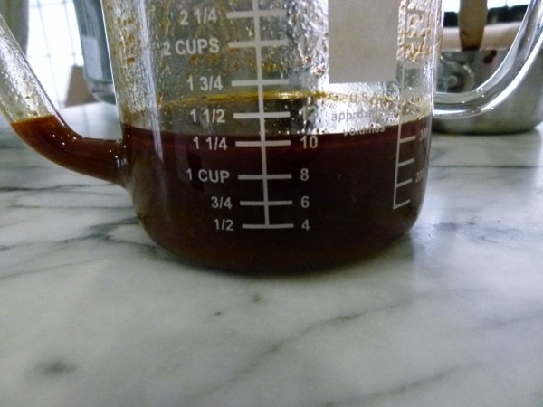 pour braising liquid in a fat separator