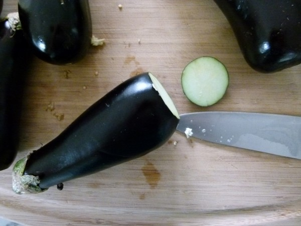 slice from the bottom of the eggplant leaving the stem intact