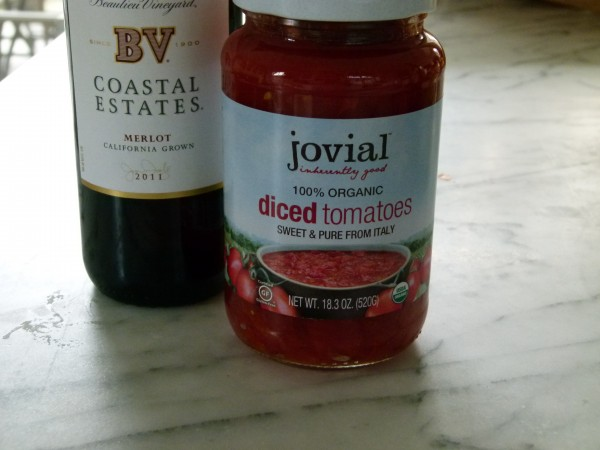dry red wine and organic diced tomatoes in a glass jar
