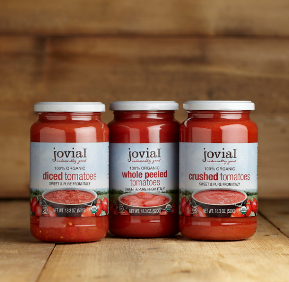 Jovial organic tomatoes in glass jars