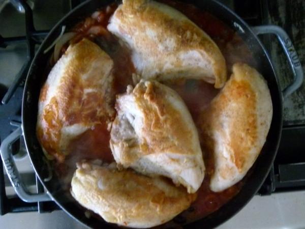 nestle chicken in the tomato mixture
