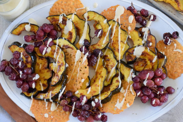roasted acorn squash with roasted grapes, frico and pine nut dressing | pamela salzman