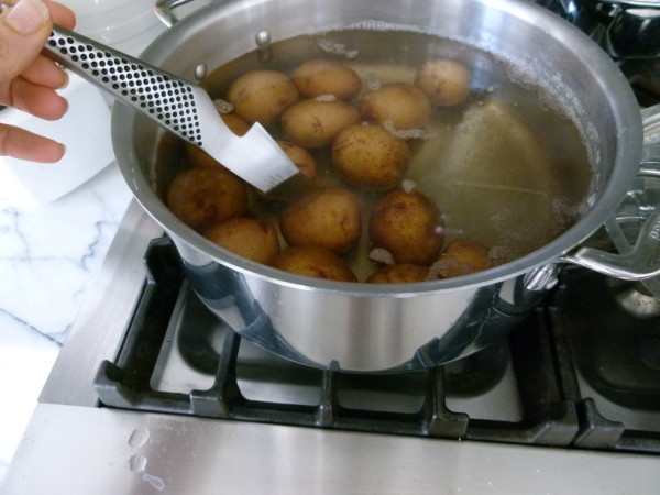 pierce potato with paring knife to determine doneness