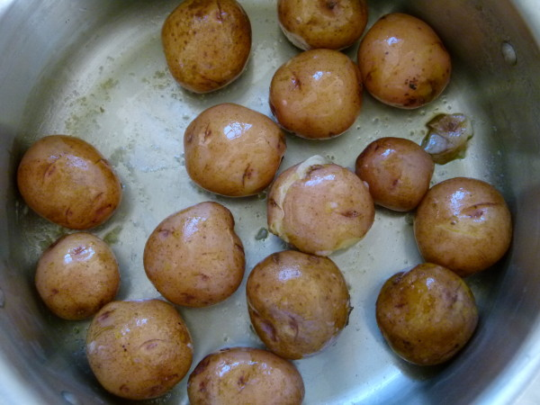 toss boiled potatoes in a little oil