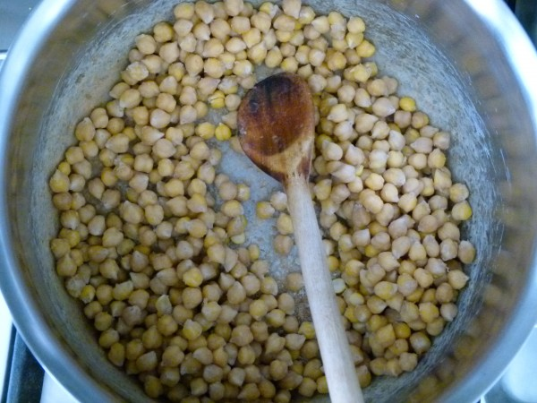 cook the soaked, drained chickpeas with a little baking soda before boiling