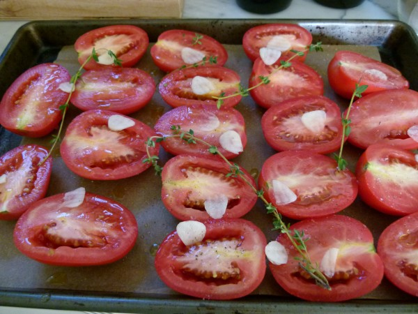 raw tomatoes prepped for roasting