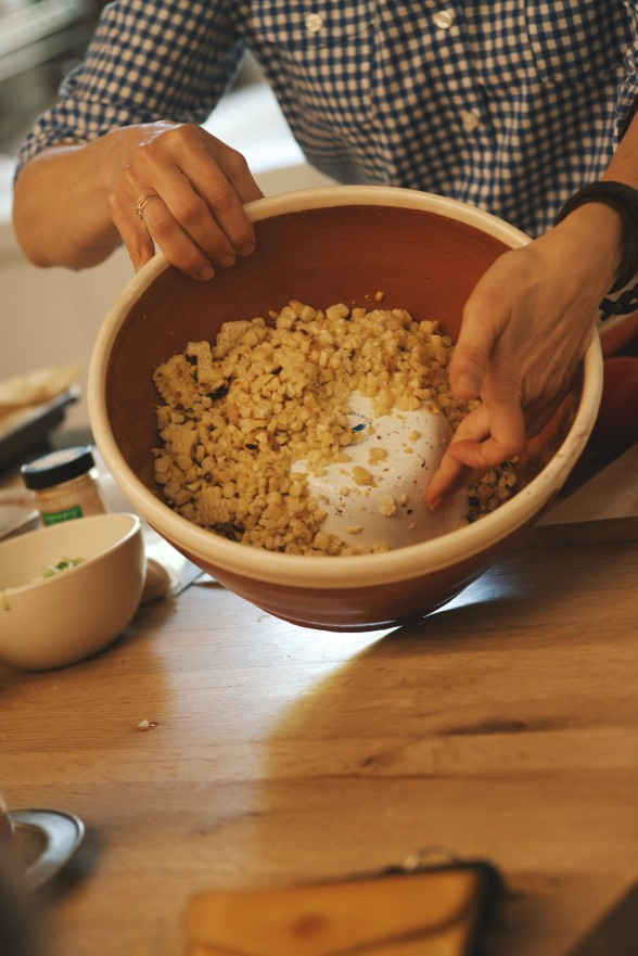 Invert a small bowl inside your serving bowl to cut corn