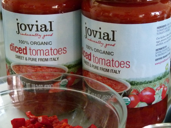 Jovial tomatoes in glass jars